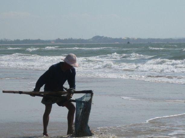 Vietnam: Fisherman on beach 2, Vietnam More Info