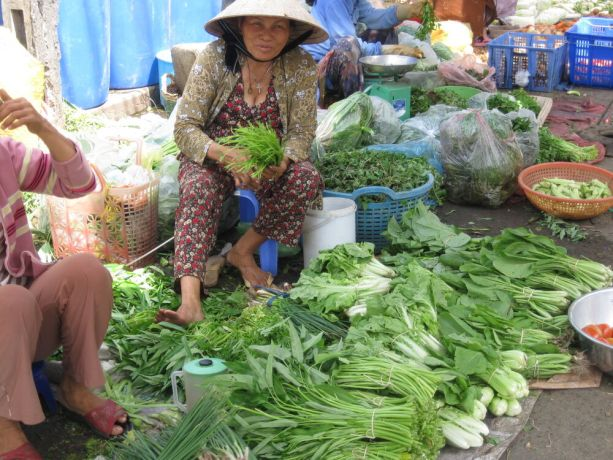 Vietnam: Woman selling vegetables, Vietnam More Info