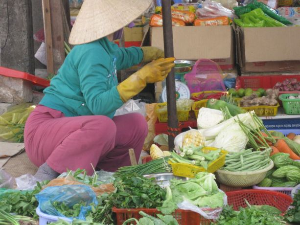Vietnam: Woman selling vegetables 2,face turned away Vietnam More Info