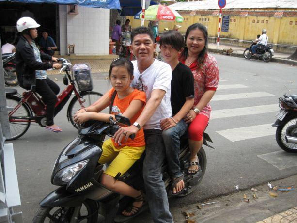 Vietnam: Family of 4 on motorbike, Vietnam More Info