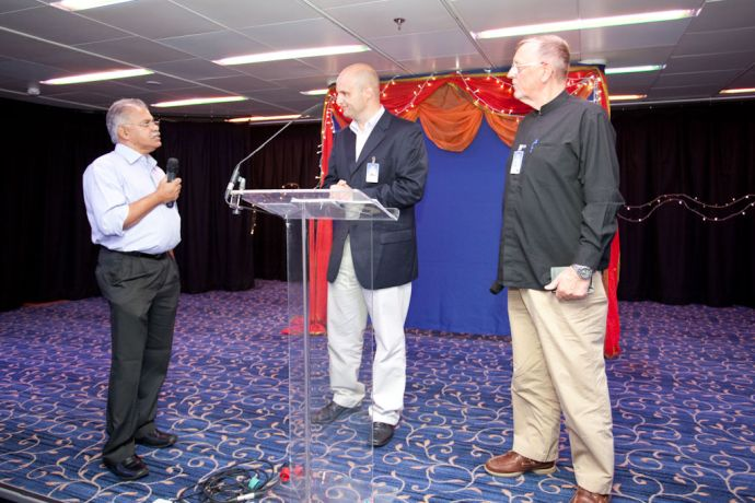 India: Kochi, India :: Andy Juliff (UK) interviews John Thomas, a long term supporter of the Ship Ministry, and Ebbo Buurma (Germany)  during a dinner to celebrate the 40th anniversary of Logos arriving in India. More Info