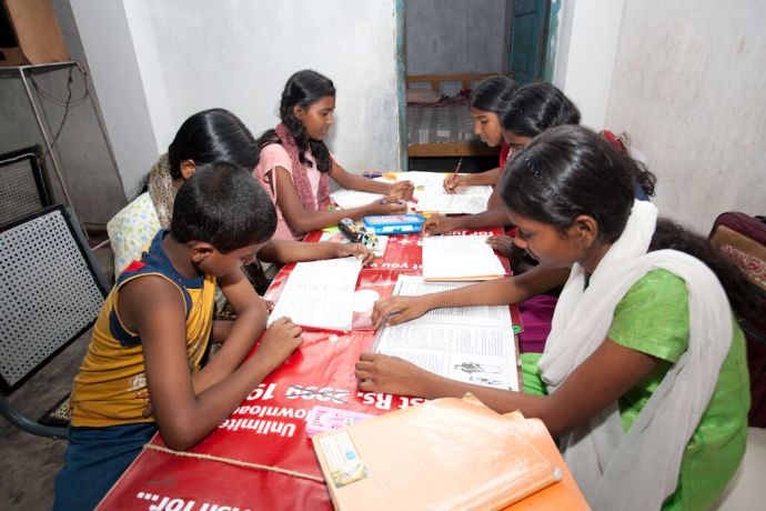 India: Kochi, India :: Children do their homework at the Christ for the World orphanage. More Info