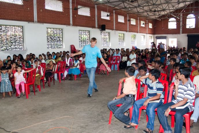 India: Kochi, India :: Harry Thiessen (Germany) plays a game with children at a Vacation Bible School. More Info