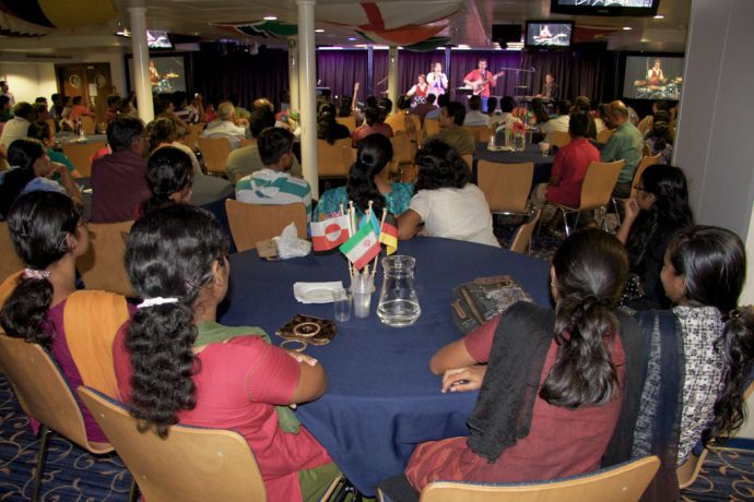 India: Kochi, India :: Crewmembers perform at a Music Café event on board Logos Hope. More Info