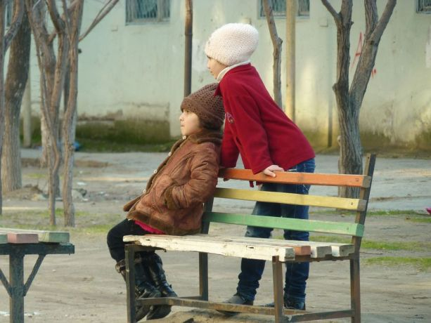 Caucasus: Two girls in rapt attention More Info