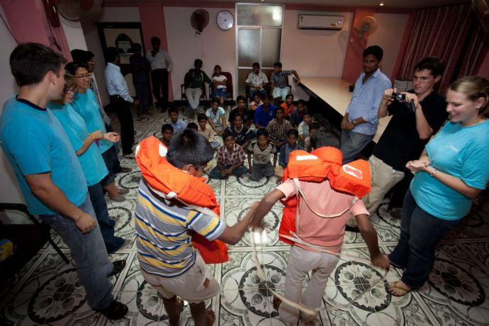 India: Visakhapatnam, India :: Crewmembers organise a lifejacket game at a YMCA home. More Info