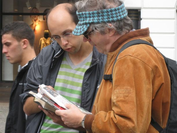 Sweden: Summer Team member Michael shares Scripture and talks with man on street at Malmo Festival, Sweden.  More Info