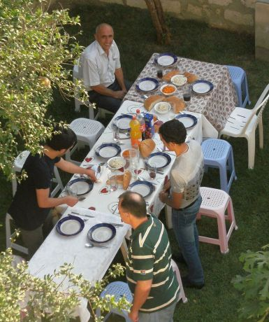 Caucasus: Family and friends celebrate the health of a team member who recovered from cancer. More Info