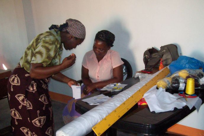 Mozambique: Two women developing sewing skills, which will help them to earn a living, at Tabitha Center, Mozambique. More Info