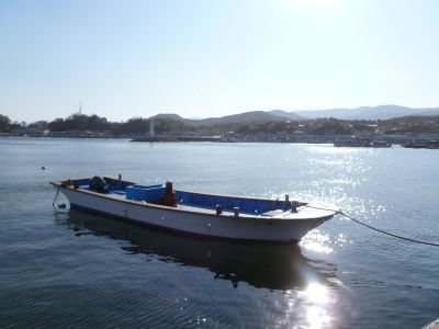 South Korea: A fishing boat drifts peacefully in the late afternoon sun. Even though very close to the worlds most heavily guarded border between North and South Korea life and livelihoods must continue. More Info