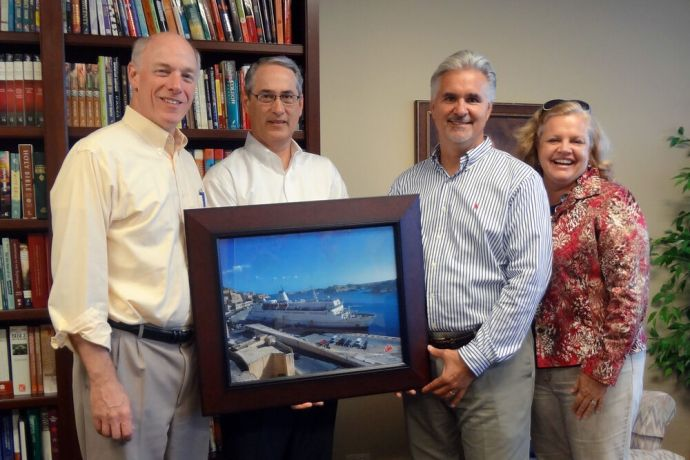 United States: Illinois, USA :: (Left to right) Tyndale House Publishing President Mark Taylor and Vice President Doug Walton receive a framed print of Logos Hope from Randy and Kim Grebe on behalf of OM Ships. More Info
