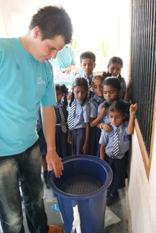 India: Visakhapatnam, India :: Joost Claessen (Netherlands) sets up a water filter at a Good Shepherd school. More Info