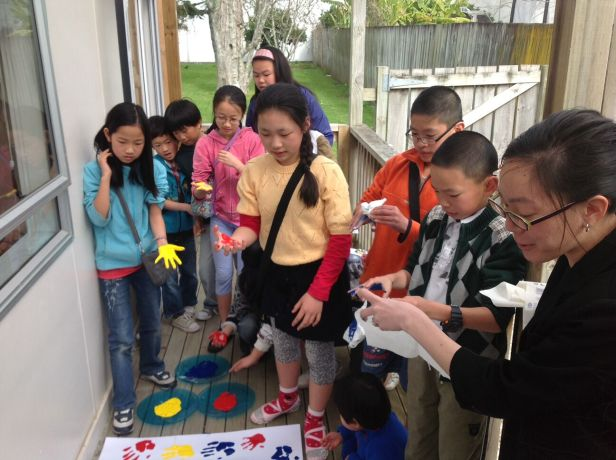 New Zealand: Children from Auckland City Mandarin church learn about missions and place their hand-print around a map of the world. More Info