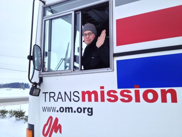 Finland: Tuukka Linkopuu, from Finland, waves goodbyes as he begins his second year as the Bus4Life driver. More Info
