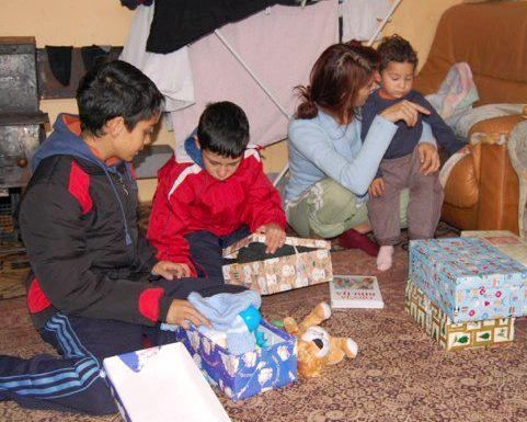 Bosnia & Hercegovina: A Roma family rejoicing over their presents More Info