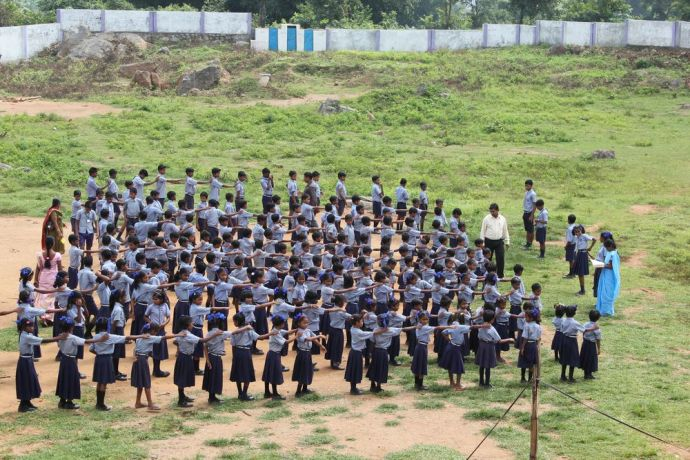 India: School children line up in the morning in Luhagud, Odisha in India. More Info