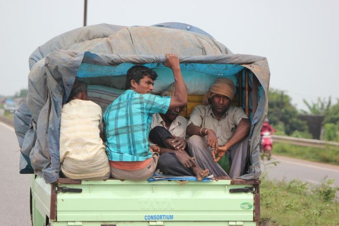 India: Dalit men get a ride into town in Odisha, India. More Info
