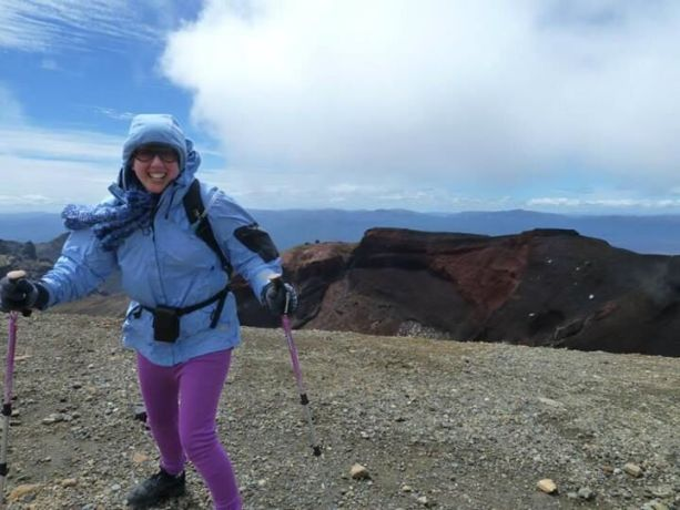 New Zealand: Co-organiser Suzanna Irwin battles strong winds to stay upright, next to the Red Crater atop Mount Tongariro during Freedom Climb New Zealand 2013. More Info