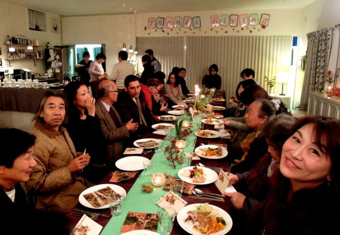 """Japan: Twenty-six English Cafes participants enjoyed Thanksgiving Dinner complete with turkeys, pies, cakes and other treats at Hopehouse Kanazawa last month. Before the start of dinner, everyone wrote a """"Thank you"""" card and gave it to another person. The story of the healing of the ten lepers was shared, and after giving thanks in prayer for the food, eating could begin! A participant from Egypt was really grateful for the opportunity to experience Thanksgiving for the first time. More Info"""