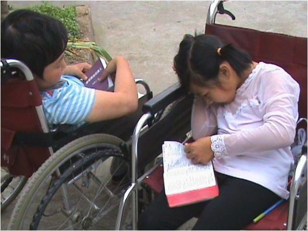 Far East: A Chinese girl is learning to read the Bible at the Sunshine Welfare Centre, a project of OM China. More Info