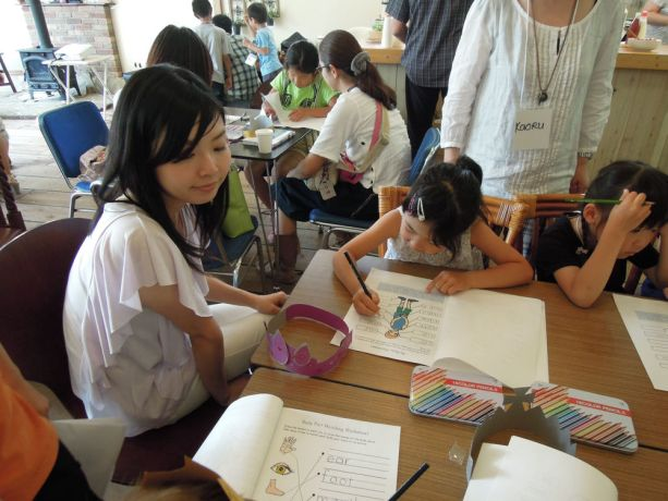 Japan: Children make their own crowns at The Eagle Child/Parent Event, to illustrate they they can all be superheroes. Parents participate in the fun with their children.  More Info
