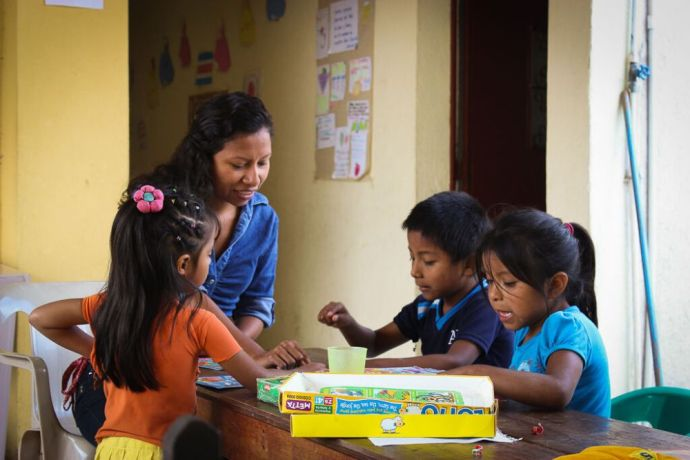 A volunteer working with OM Guatemala enjoys playing with the children of Project Rescue, a ministry focused on families and children living in great poverty.