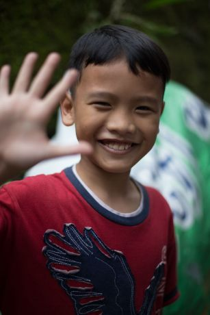 Indonesia: Indonesian boy waves a hello  More Info