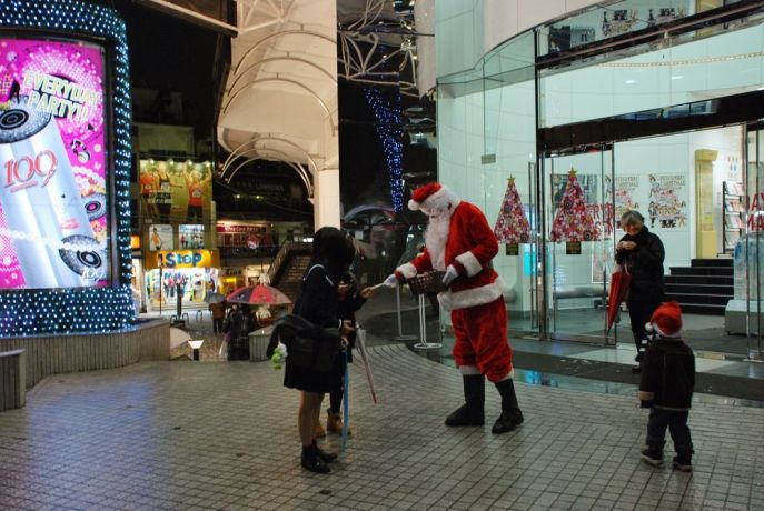 Japan: Santa hands out Christmas tracts in front of a shopping mall in Katamatchi, the city centre of Kanazawa. More Info