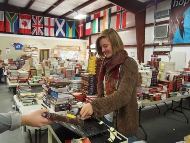 United States: Florence, SC, USA :: Mareike Fritschen (Germany) scanning and sorting Bibles in the Ministry Center while in Florence on her Outbound team. More Info