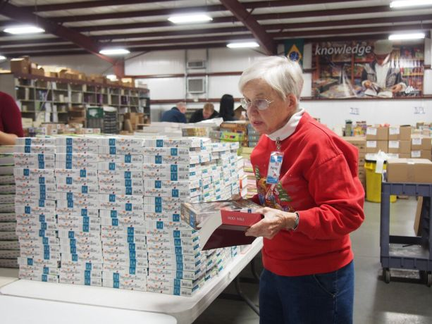 United States: Florence, SC, USA :: Local volunteer Penny sorting Bibles in the Ministry Center. More Info