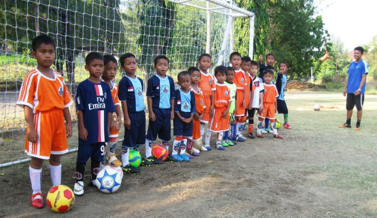 Indonesia: Young football stars line up for a photo during their weekly practice. More Info
