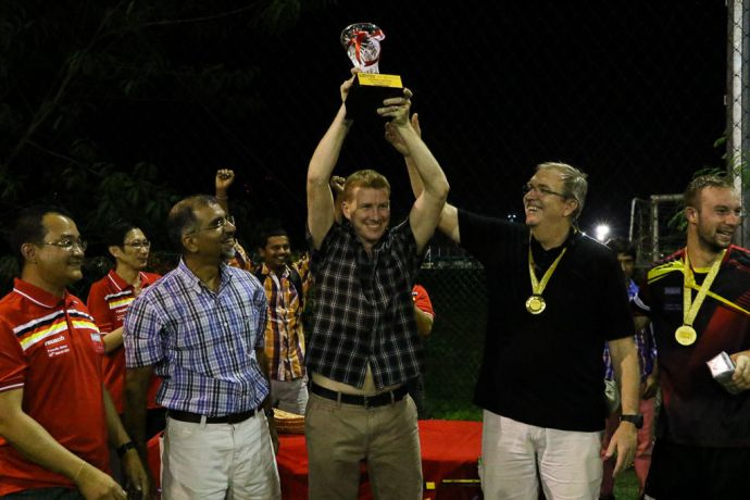 Singapore: Harbour Front, Singapore :: Senior Project Manager of Power Up Project, We Lin Chan (Singapore) with Marine Super Intendant, Elon Alva, Project Manager, Matt Blair (both Australia) and Captain of Logos Hope, Tom Dyer (USA) as they win the winners trophy at the friendly football match against Keppel Shipyard. More Info