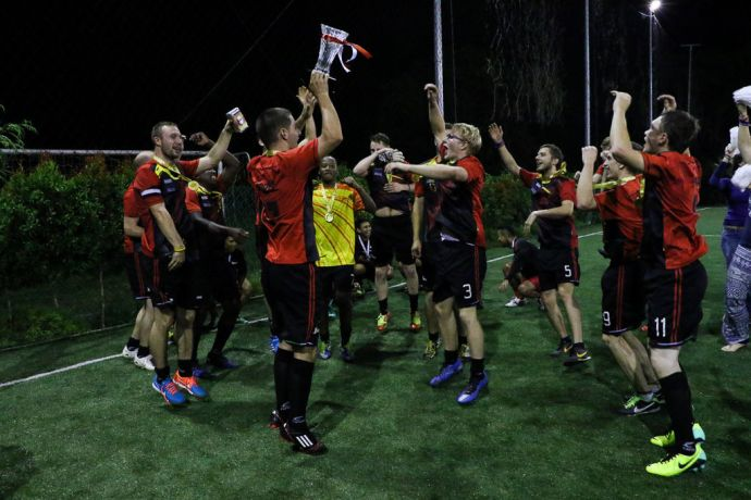 Singapore: Harbour Front, Singapore :: Logos Hope football team celebrate after they win the friendly match agaisnt Keppel Shipyard. More Info