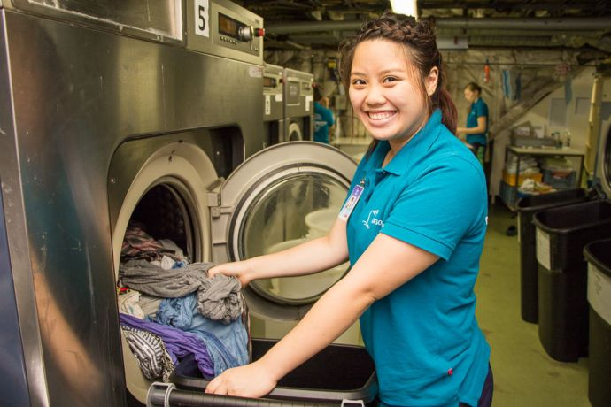 Singapore: At Sea :: Joey Lee (Singapore) works in the laundry room as part of the Hotel Services department. More Info