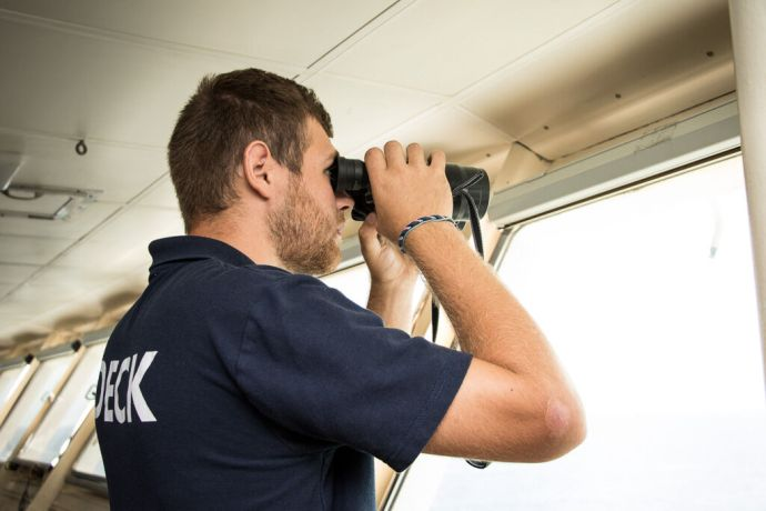 Singapore: At Sea :: Deck Rating, Joshua Mudd (Northern Ireland) keeps watch from the bridge. More Info