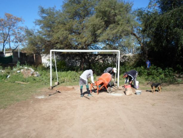 Argentina: Volunteers helping to set up the goals for the new football court in Córdoba, Argentina More Info