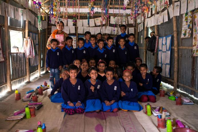 South Asia: These children are dreaming of the future together. Education creates community and change. More Info