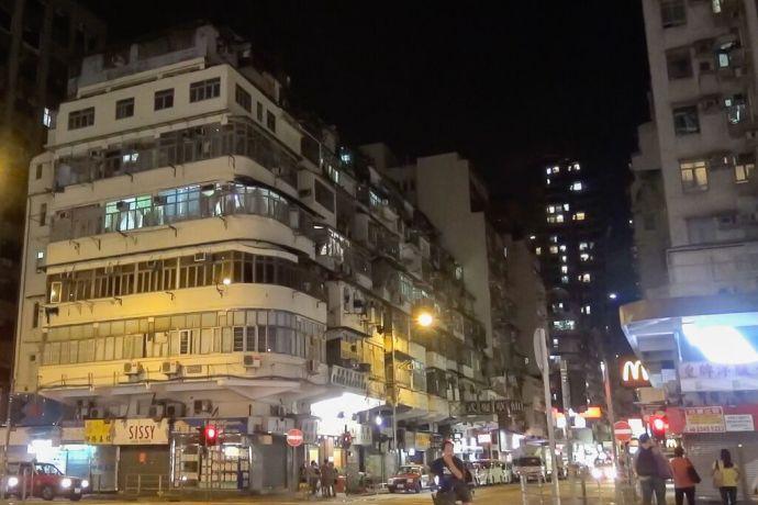 Hong Kong: Hong Kong, Hong Kong :: An old building in Hong Kong where illegal rooftop houses are built at the top More Info