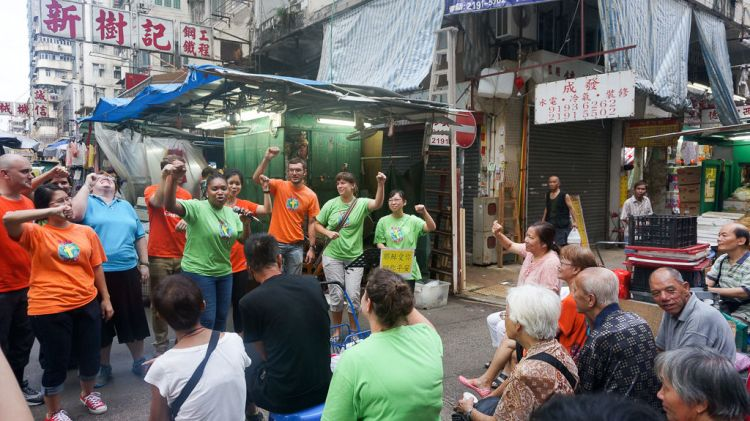 Hong Kong: Hong Kong, Hong Kong :: A team from Logos Hope sing songs in the middle of a busy wet market. More Info