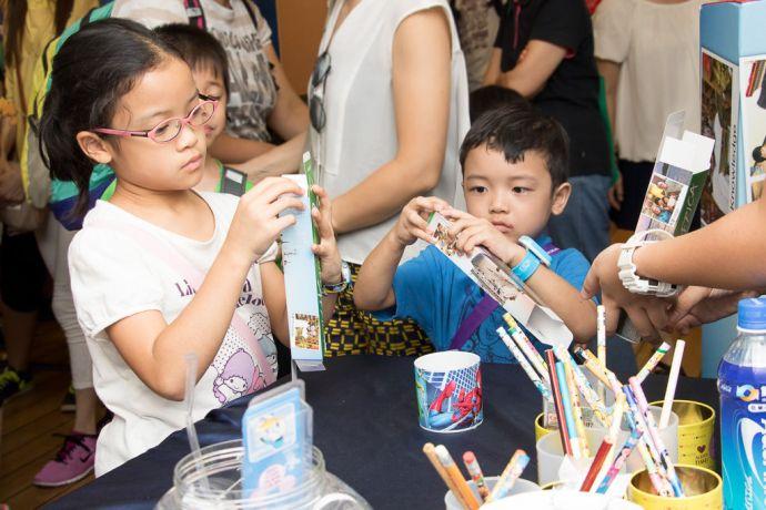 Hong Kong: Hong Kong, Hong Kong :: Children make boxes of pencils to raise money for the children in Africa. More Info