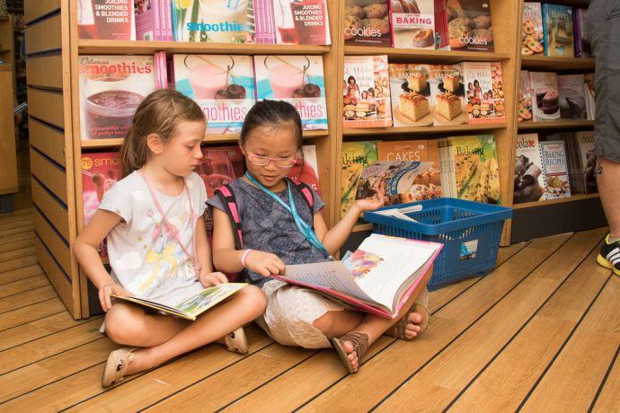 Hong Kong: Hong Kong, Hong Kong :: Children enjoy reading books in the bookfair. More Info