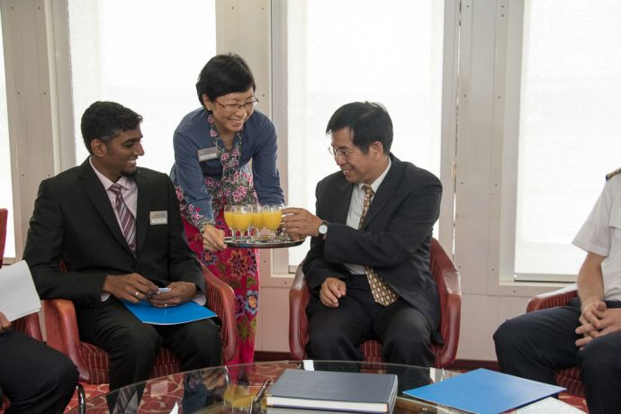 Taiwan: Taichung, Taiwan :: Irene Hui (Singapore) serving drinks to Deputy Mayor Mr. Pan, Wen-Zhong with Director Seelan Gonvender (South Africa) in the VIP Lounge. More Info