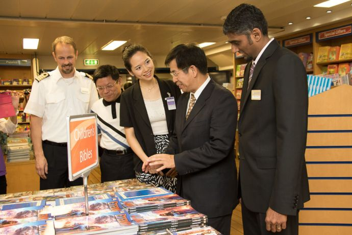 Taiwan: Taichung, Taiwan :: Captain Dirk Colenbrander (Netherlands), Kaoshiung Library Director, Chun-Fu Shih, Translator Joanne Lee, Deputy Mayor Mr. Pan, Wen-Zhong and Director Seelan Govender (South Africa) browse through the bookfair together at the Official Opening event onboard. More Info
