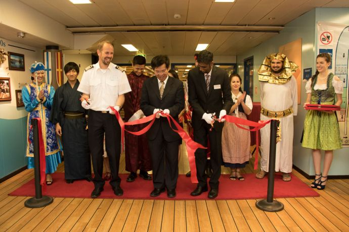 Taiwan: Taichung, Taiwan :: Captain Dirk Colenbrander (Netherlands), Deputy Mayor Mr. Pan, Wen-Zhong and Director Seelan Govender (South Africa) cut the ribbon at the Official Opening event onboard on the Experience Deck. More Info