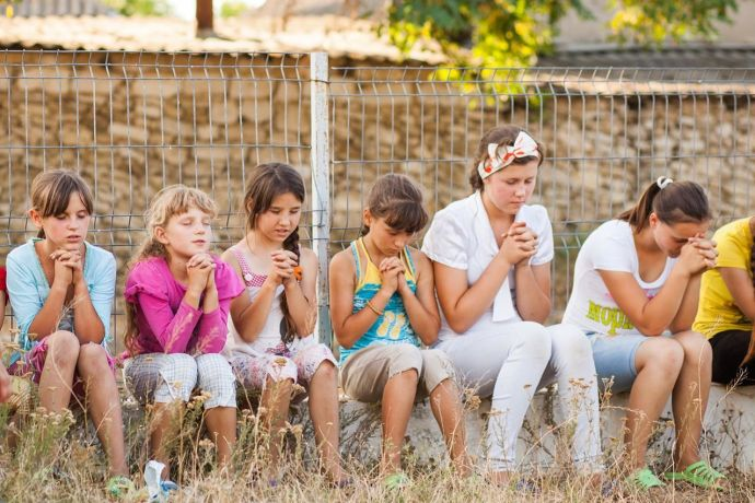 Moldova: Moldovan children are joining in prayer during a programme organised in their village by one of OM's 'Love Moldova' outreach teams this summer (2015). More Info