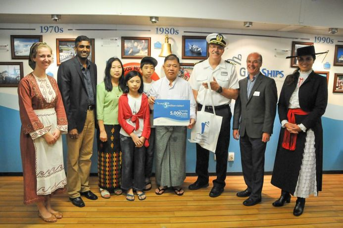 Myanmar: Yangon, Myanmar :: The five millionth visitor Mr. U Tin Hla and his family are welcomed to Logos Hope by Director Seelan Govender (South Africa), Captain Tom Dyer (USA) and Managing Director of Public Ministries Ronnie Lappin (UK). More Info