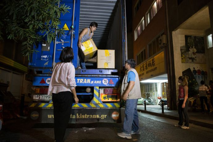 Greece: Volunteers from Samaria Centre unloading a container of donated items for the refugees.  Photo credit: Kathryn Berry More Info