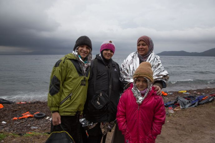 Greece: Recent refugee arrivals on the Greek island of Lesbos with the emergency foil sheets underneath their wet jackets More Info