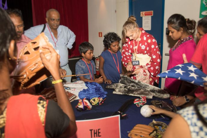 Sri Lanka: Colombo, Sri Lanka :: Kate Pesile (USA) connects with local children by showing them the culture of her country at the Meet the Nations event in the Hope Theatre. More Info