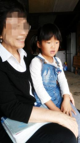 Far East: A young child in Yvonne's arm More Info